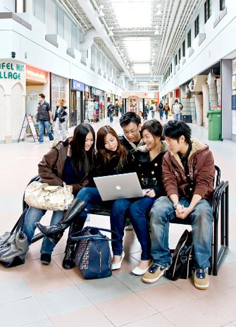 Students looking at a computer