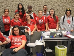 A photo from a 2013 blood drive when members of the York Lions football and women's rugby teams made donations