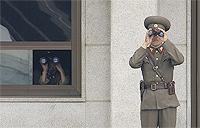 North Korean soldiers look south