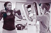 Two women practicing Muay Thai