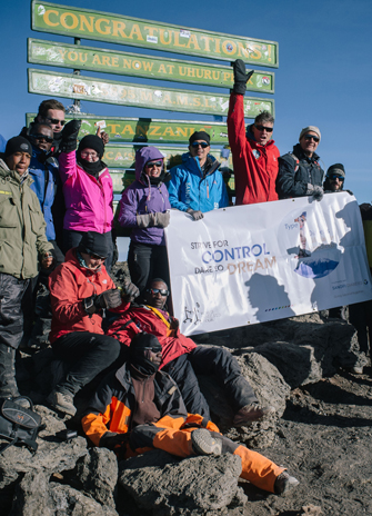 Diabetes team and their guides at summit of Mt. Kilimanjaro