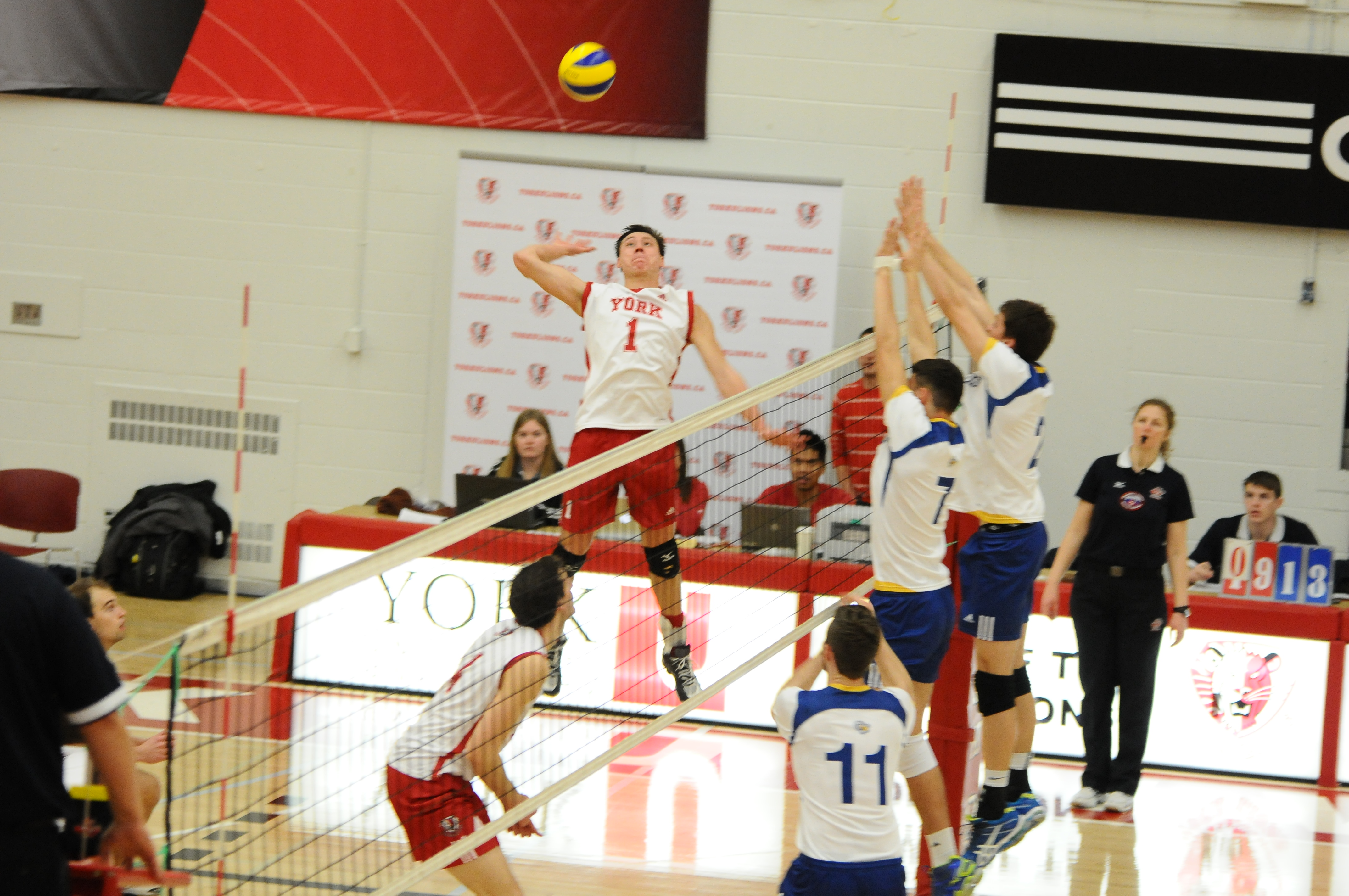 Ray Szeto jumping to return a volley during a game against Ryerson University.