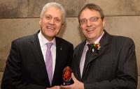 Mamdouh Shoukri present a award to Laurence Harris