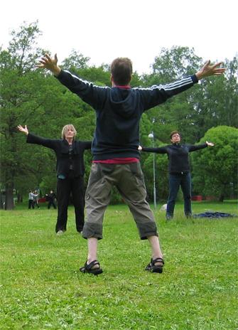 Three people exercising
