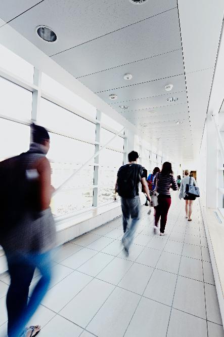 students walking in the TEL Building walkway