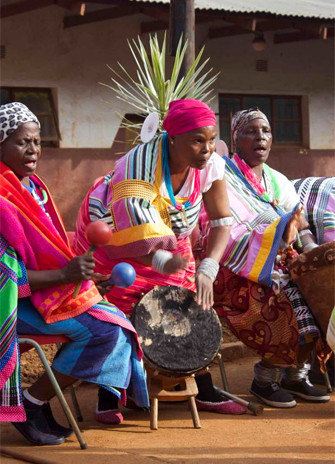Village women play instruments sing and dance to welcome York students