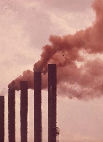 smoke stacks spewing pollutants
