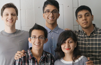 five students in a group taking a picture