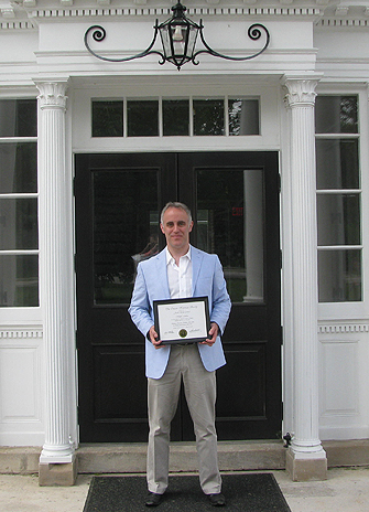William Jenkins holding his OHS award