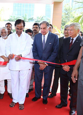 Chief Minister of Telangana Chandrasekhar Rao cuts the ribbon for the new campus as Ratan Tata and Dezsö Horvath look on from the right
