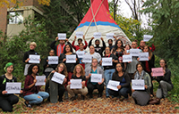 Sisters in Spirit vigil participants pose in front of the York Tipi