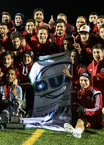 OUA Men's Soccer Champions cropped for YFile homepage. Team picture with the championship banner.