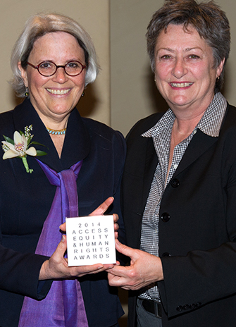 Anne Rochon Ford (left) receives the Constance E. Hamilton award from Toronto City Councillor Janet Davis