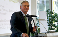 Peter Love at podium