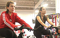 Two people participating in cycle fit