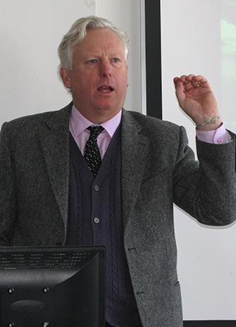 David Miller speaks in Professor Peter Love's FES class