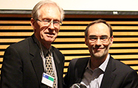 Wade Cook receives the Dean's Research Impact Award for Lifetime Achievement from Markus Biehl, associate dean, research at Schulich