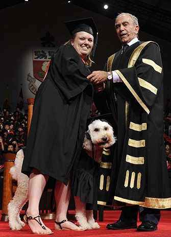 York University student Devon MacPherson crossed the convocation stage today with her mental health service dog Barkley