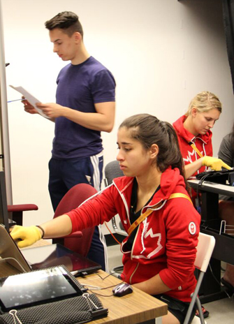 Members of the women's handball team participate in a series of tests to determine how, as elite athletes, their brains process information and the resulting actions
