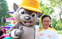Chris Chen with Pan Am mascot featured image for YFile homepage