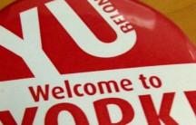 YU Belong button for volunteers