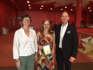 Theatre Department Chair Elizabeth Asselstine (left) and AMPD Dean Shawn Brixey (right) stand with Professor Laura Levin, recipient of the 2015 School of the Arts, Media, Performance & Design Senior Teaching Award