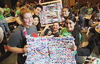 Clockwise, from bottom left: Hilary Davidson, Annie Mieu, Johnny Luong, Diana Lee, Manpreet Gulri and (centre) Nicole Maloy show off their handiwork during the first milk bag mattress weaving event