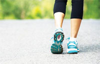 person wearing runners and walking