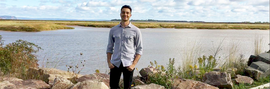 image of York graduate student Steve Sangiuliano standing on a beach