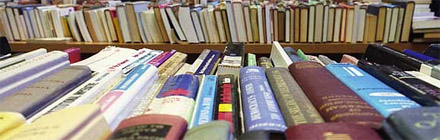 Tables piled with books