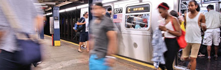 subway riders get off a train