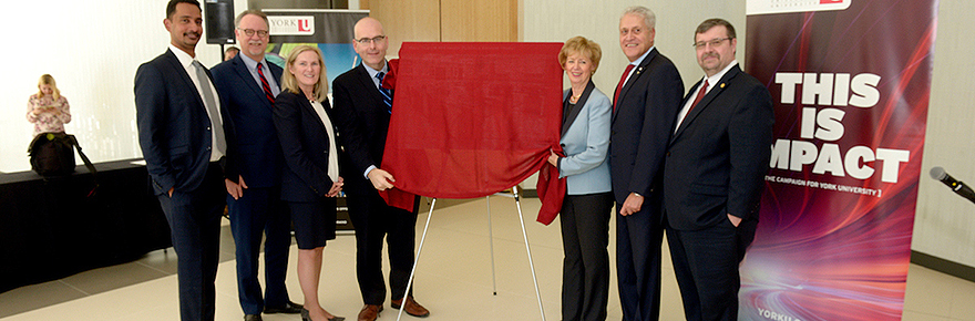 A delegation of University officials and ministers from federal and provincial government unveil a photograph at the Strategic Investment Fund announcement on Feb. 17 at the Keele campus