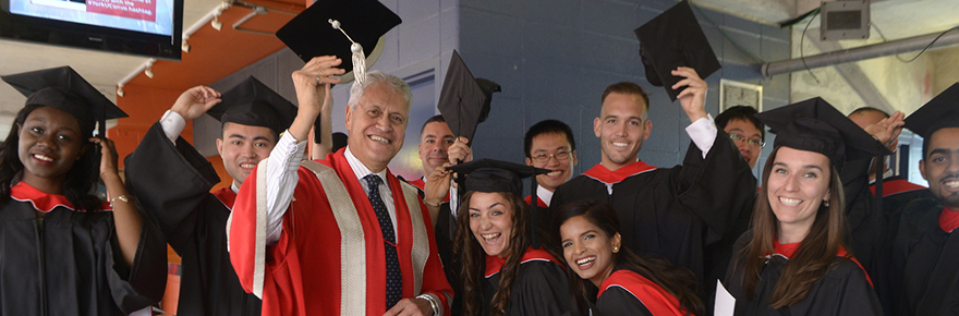 York U President surrounded by grads at convocation