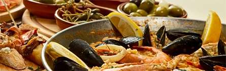 A platter of Italian food, including cured meats, pasta and seafood