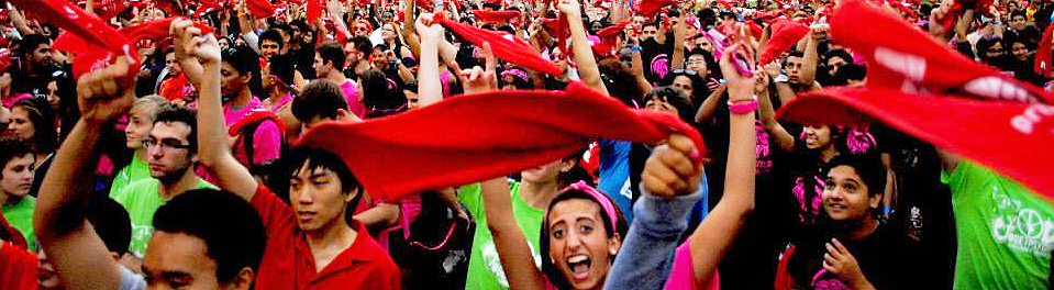 students wave red towels at a gathering at the 2015 York U orientation welcome event