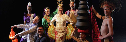 The dance troupe with professor, dressed in traditional dress