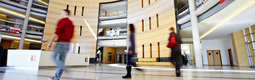 People walk through Vari Hall, which is located on York U's Keele campus