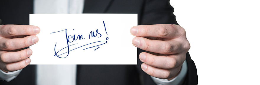 """An image of a man's hands holding a card that says """"Join us!"""""""