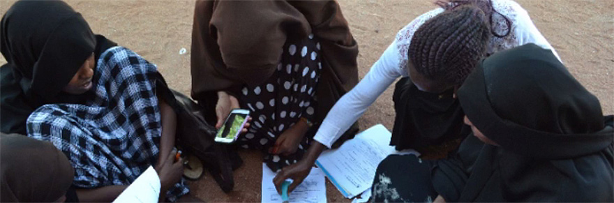 Students in the Dadaab Refugee Camp work on an assignment for their studies with York University
