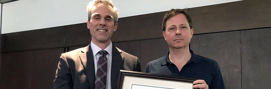 FGS Dean Thomas Loebel (left) presented the Faculty of Graduate Studies Teaching Award to Professor Richard Murray at a Faculty Council meeting on April 4