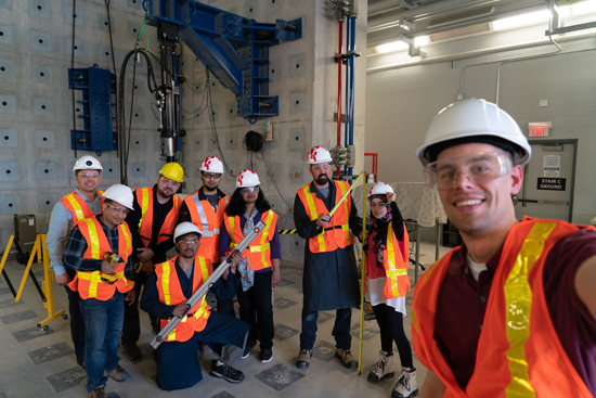 A group of individuals with hard hats and safety gear