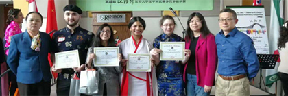 Group photo of award winners holding certificates