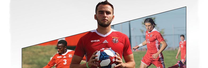 Soccer player holding a soccer ball