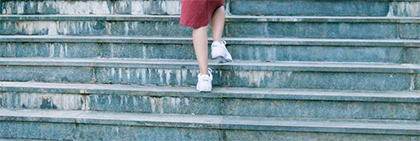 Woman walking up steps
