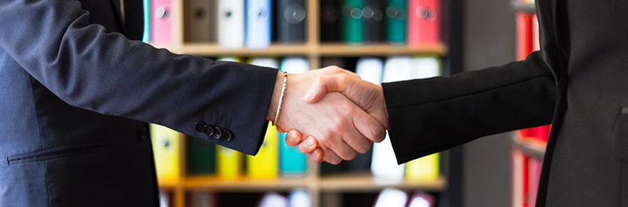 handshake and books