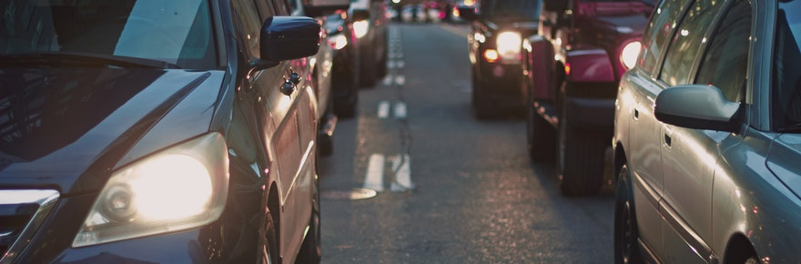 An image of cars lined up on a street in traffic