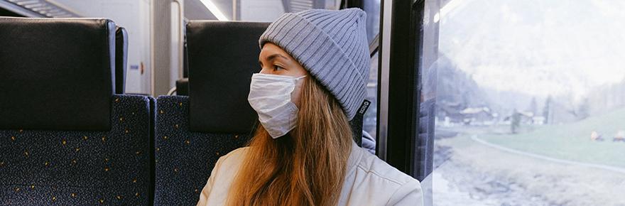 woman on train mask covid