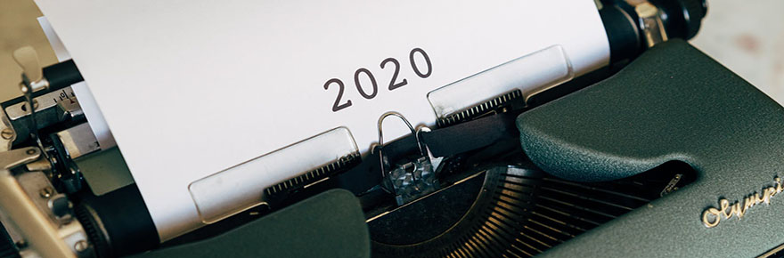 Typewriter with paper that reads 2020