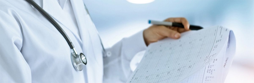 Featured image for Mackenzie Health and York U MOU signing shows a medical worker with a chart