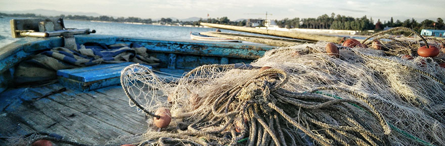 Fishing vessel deck with fishing nets